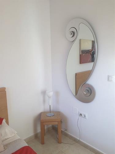 Mirror in double bedroom