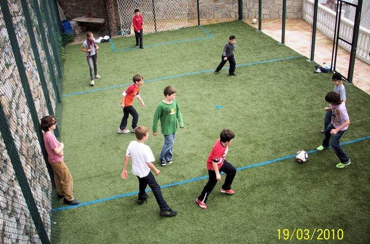 100m2 plus Astroturf, net covered, private sports court
