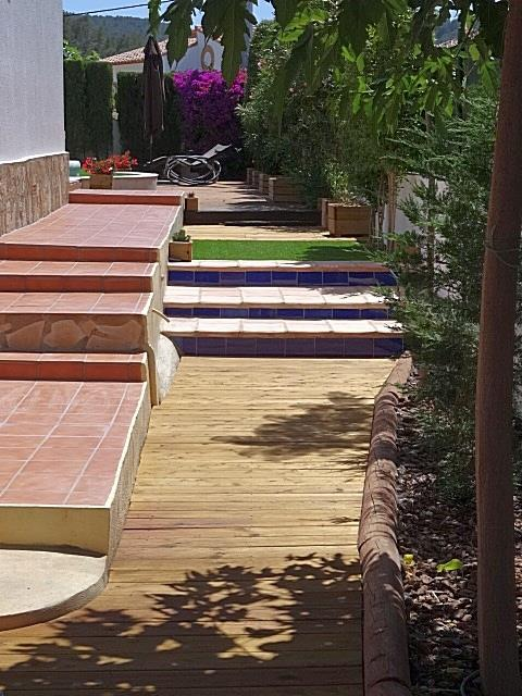 Wooden pathway continues to pool area