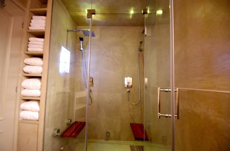 shower with teak seats - can be folded up