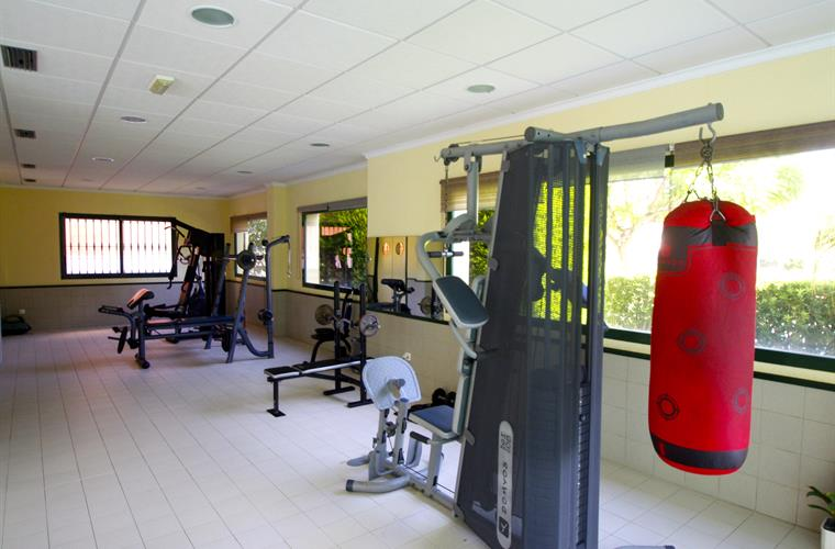 fitness area next to the indoor pool