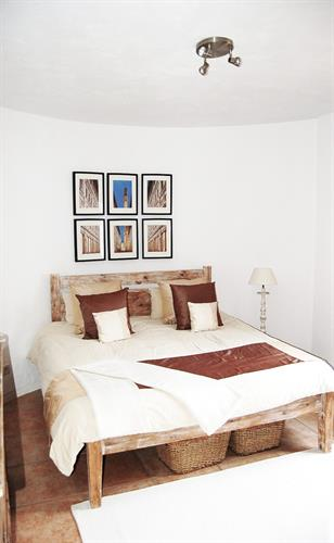 One of the spacious and airy bedrooms