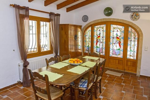 The dining area and door to summer kitchen