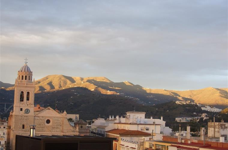 Mountain view from roof-terrace in sunset
