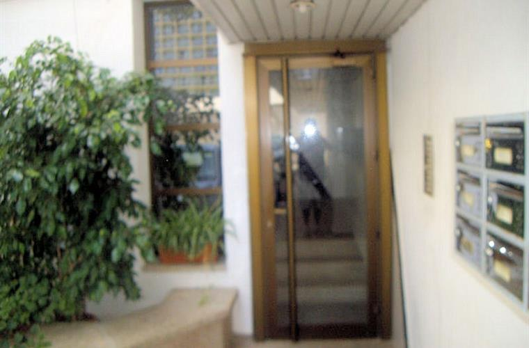 View of entrance door to apartment block