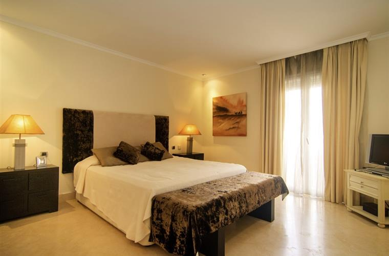 Master bedroom furnished with 180cm king size bed