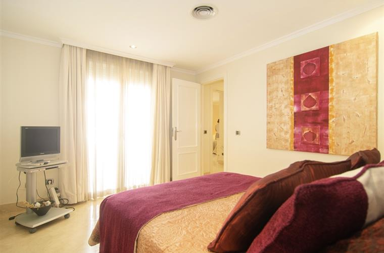 135cm double bed and large wardrobes in bedroom