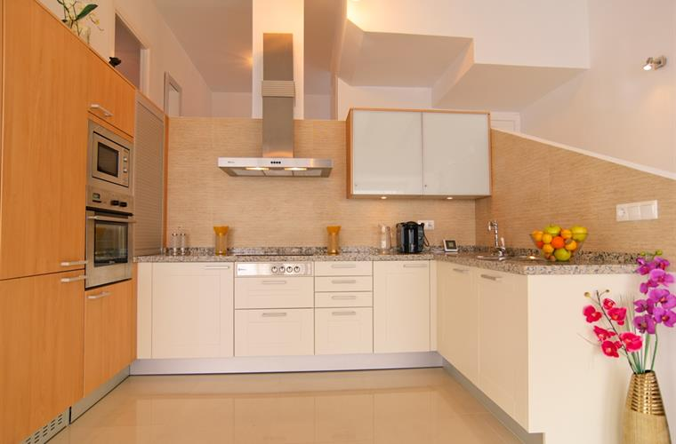 Open-plan fully equipped kitchen with new appliances