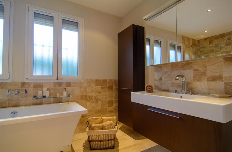 En suite bathroom with elegant appliances