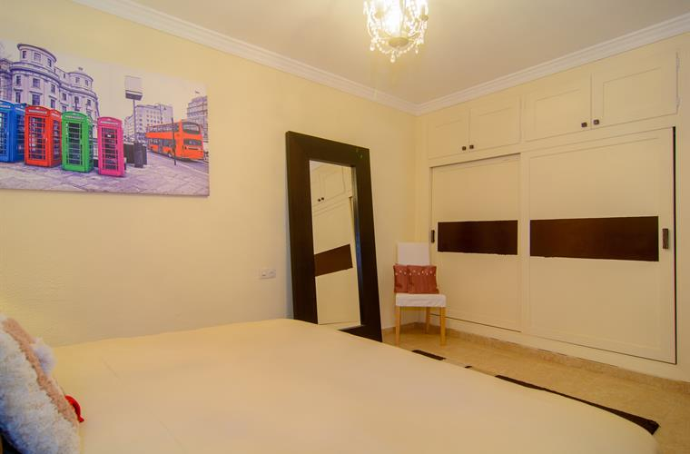 Bedroom with large wardrobe and double bed