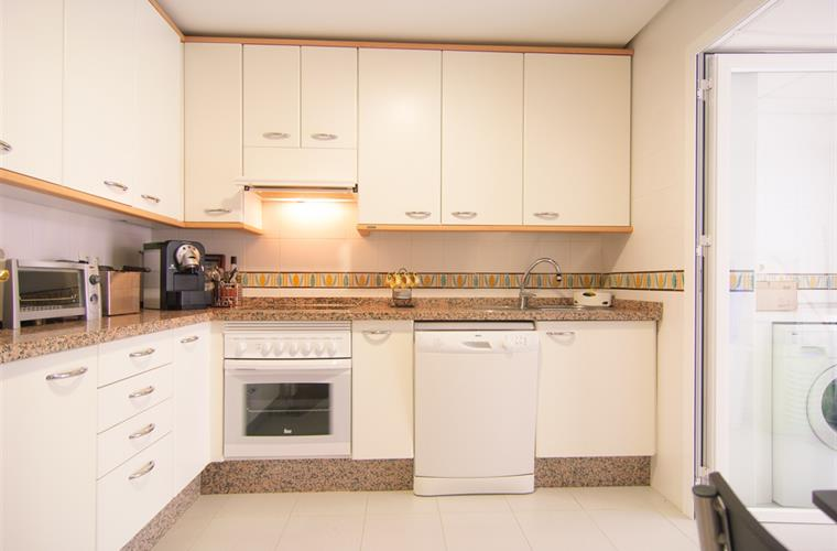 Kitchen with all necessary appliances and table