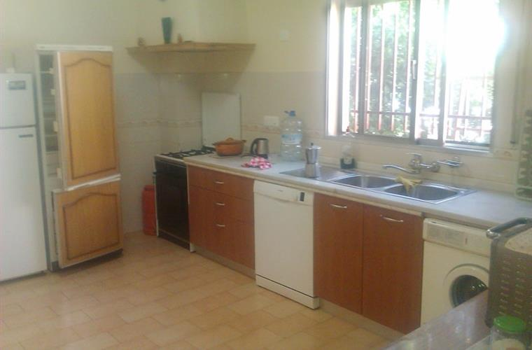 Kitchen with two fridge-freezers and washing machine