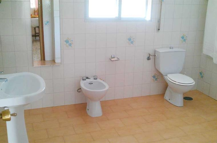 Bathroom with loo, sink and Bidet