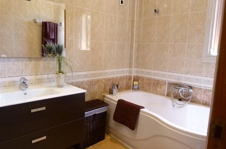 En suite bathroom with bath and separate shower