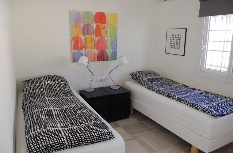 Bedroom with two high quality single beds.