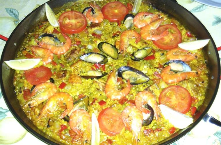 Try some traditional spanish paella
