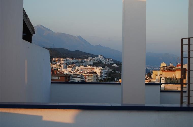 View of mountains from terrace at sunset