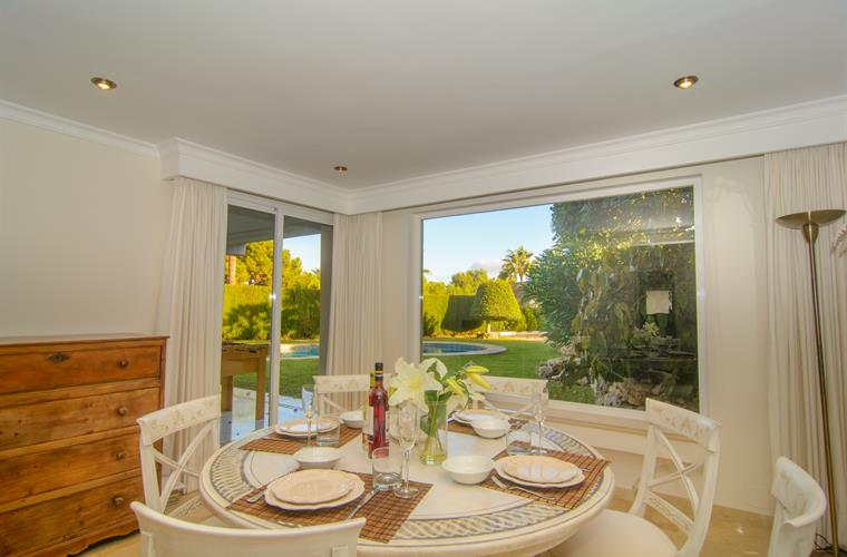 Pool views and garden accessible from dining area