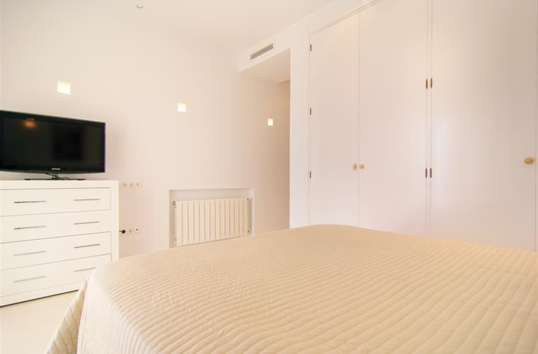 Double bed, wardrobes and flat screen TV