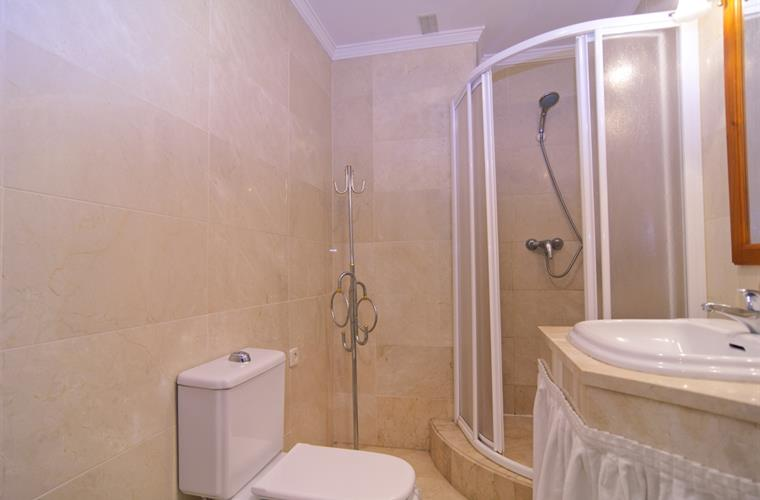 Bathroom with shower cabin, sink and toilet