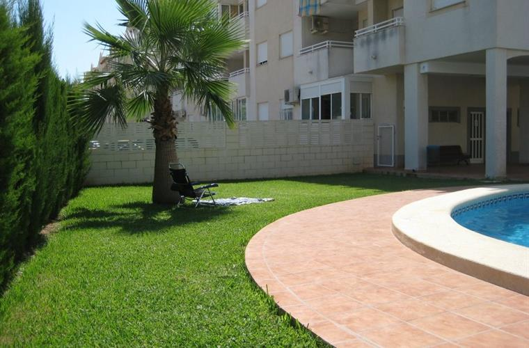 Pool area; deck chairs provided in apartment