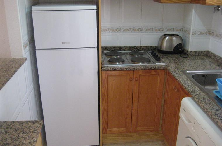 Kitchen with family size fridge and washing machine