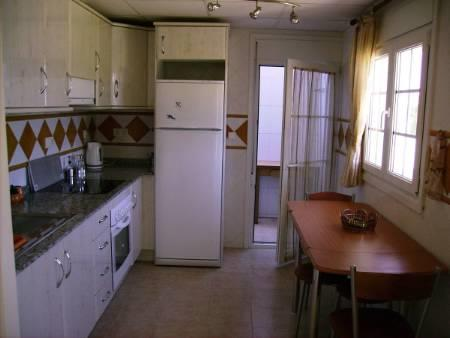 Comfortable kitchen with seperate utility room