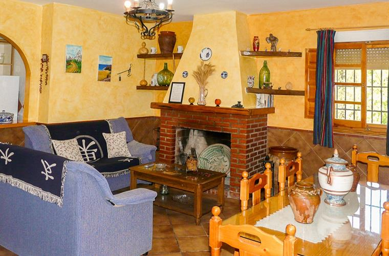 The two sofás beside the fire place and dining table on the right