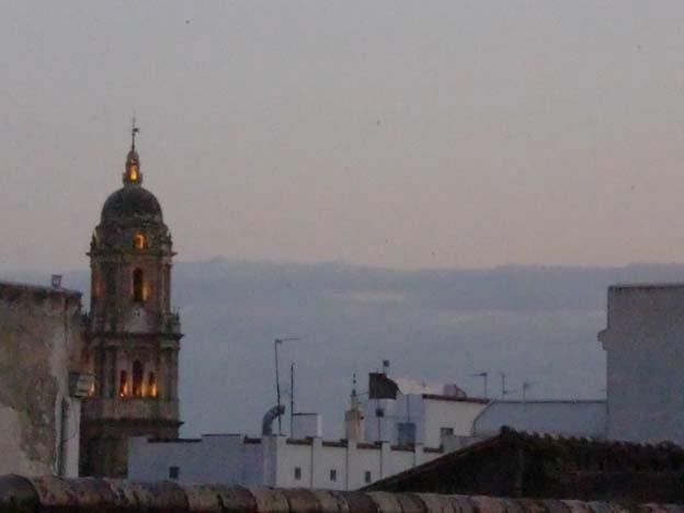 THE VIEW FROM OUR ROOF TERRASSE AT NIGHT =  OLD CATHEDRAL MALAGA