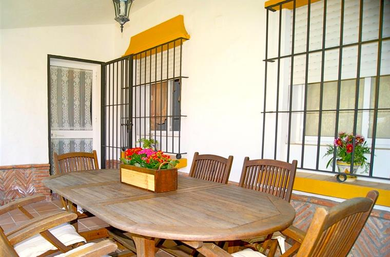 covered and furnished terrace