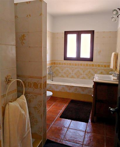 Bathroom with bath and walk-in shower on the ground floor