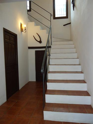 Flight of steps to the first floor with the master bedroom.