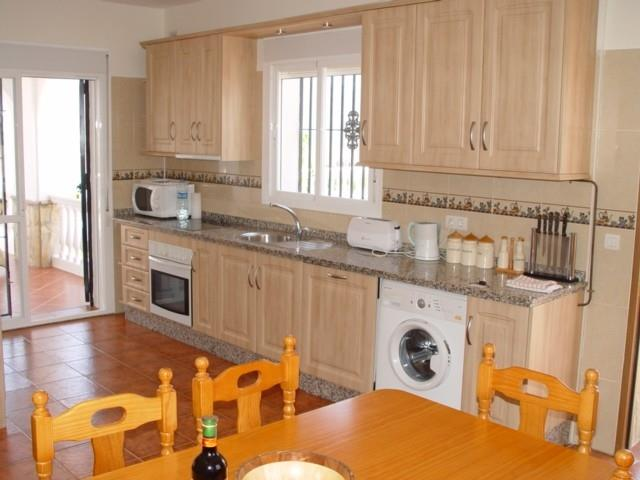 Fully equipped Dining Kitchen with patio doors to front terrace