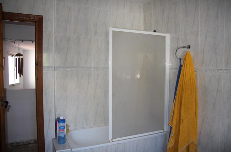 Bathroom B 2/2 ... It is located beside the Bedroom D.