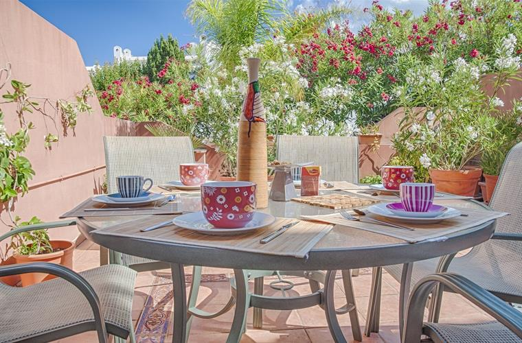 Flowery South facing front terrace perfect for breakfast or lunch