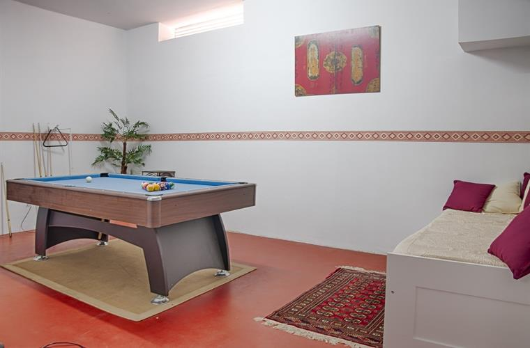Pool table in second games room with tv for video games