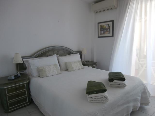double bedroom with air con and double wardrobe (unseen in photo)