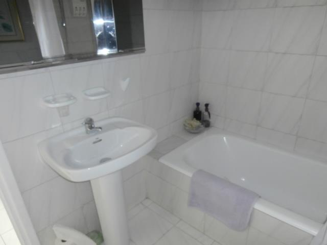 complete bathroom with shower over bath