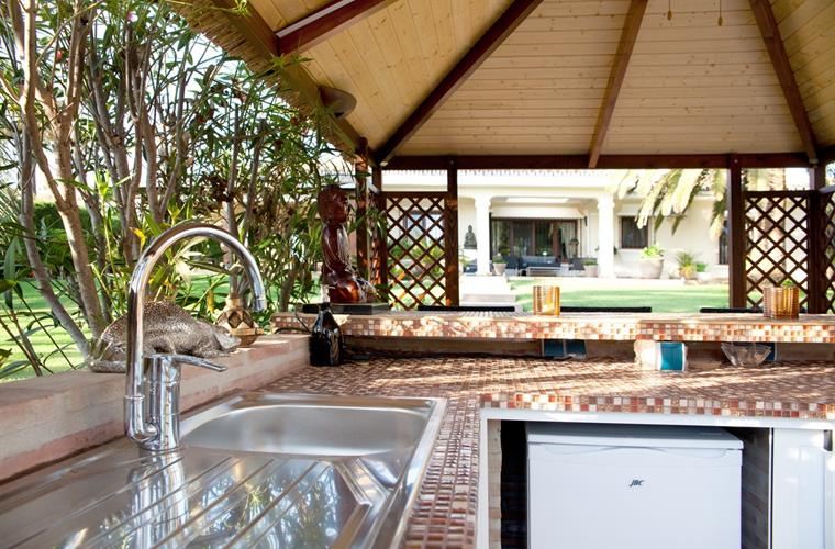 The outdoor kitchen. Isn't that great?