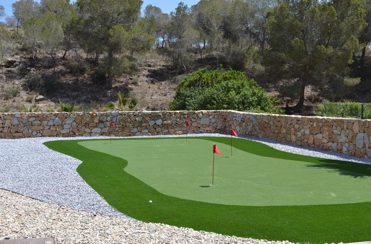 putting green at the villa