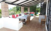 Large verandah with plenty of seating for all the family