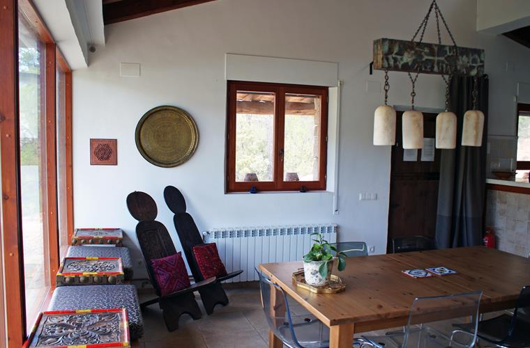 Dining area with antique furniture and lights