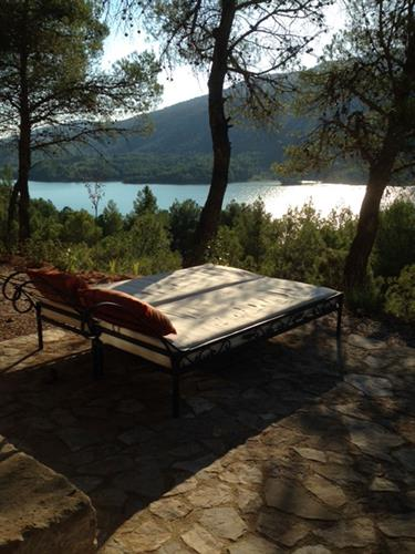 two large sun-beds with paronama lake view