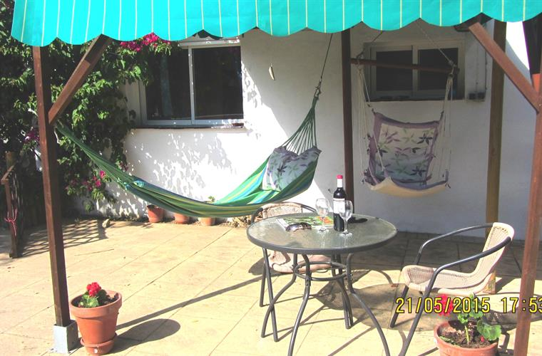 Large patio with shaded area/hammock.
