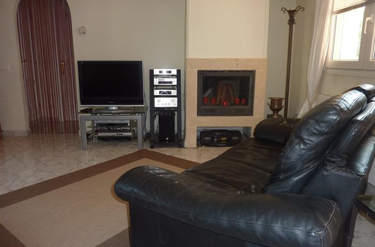 Part of lounge with wood burner and flat Screen TV