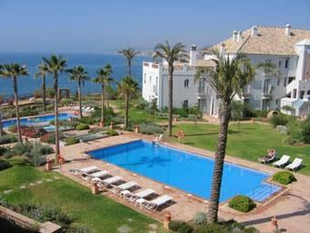 Two of the 4 pools, plus apt. overlooking the Mediterranean
