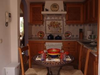 Fully Equipped Modern Kitchen, with secondary dining area.