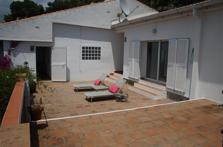 Open two levels big terrace with sun beds