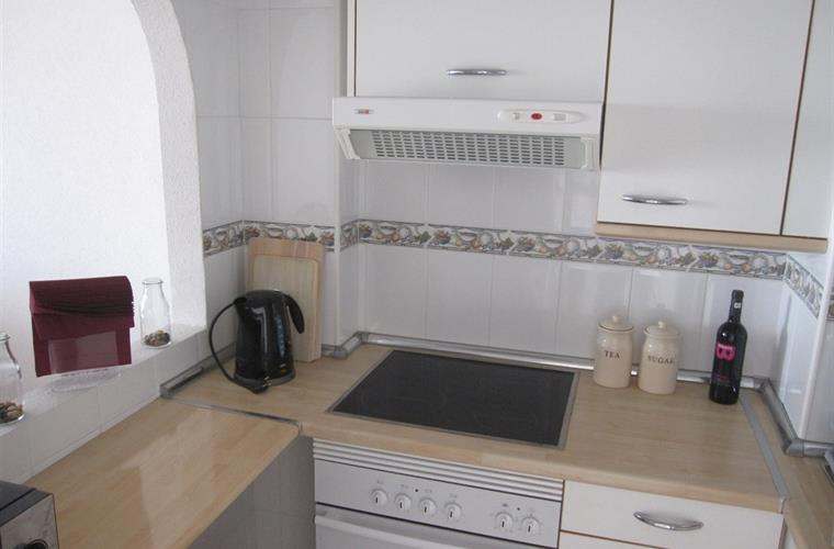 Kitchen with washing machine.