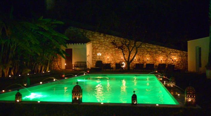 Pool terrace with evening and BBQ setting.